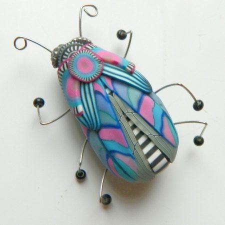 Brož hmyzák růžovomodrý