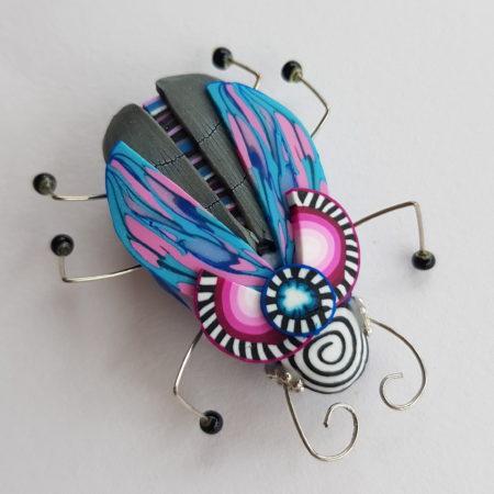 Brož hmyzák slečinka