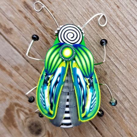 Brož hmyzák brčálový